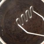Mashing a few beans with a potato masher