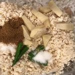 Adding aromatics and spices to urad dal in the blender