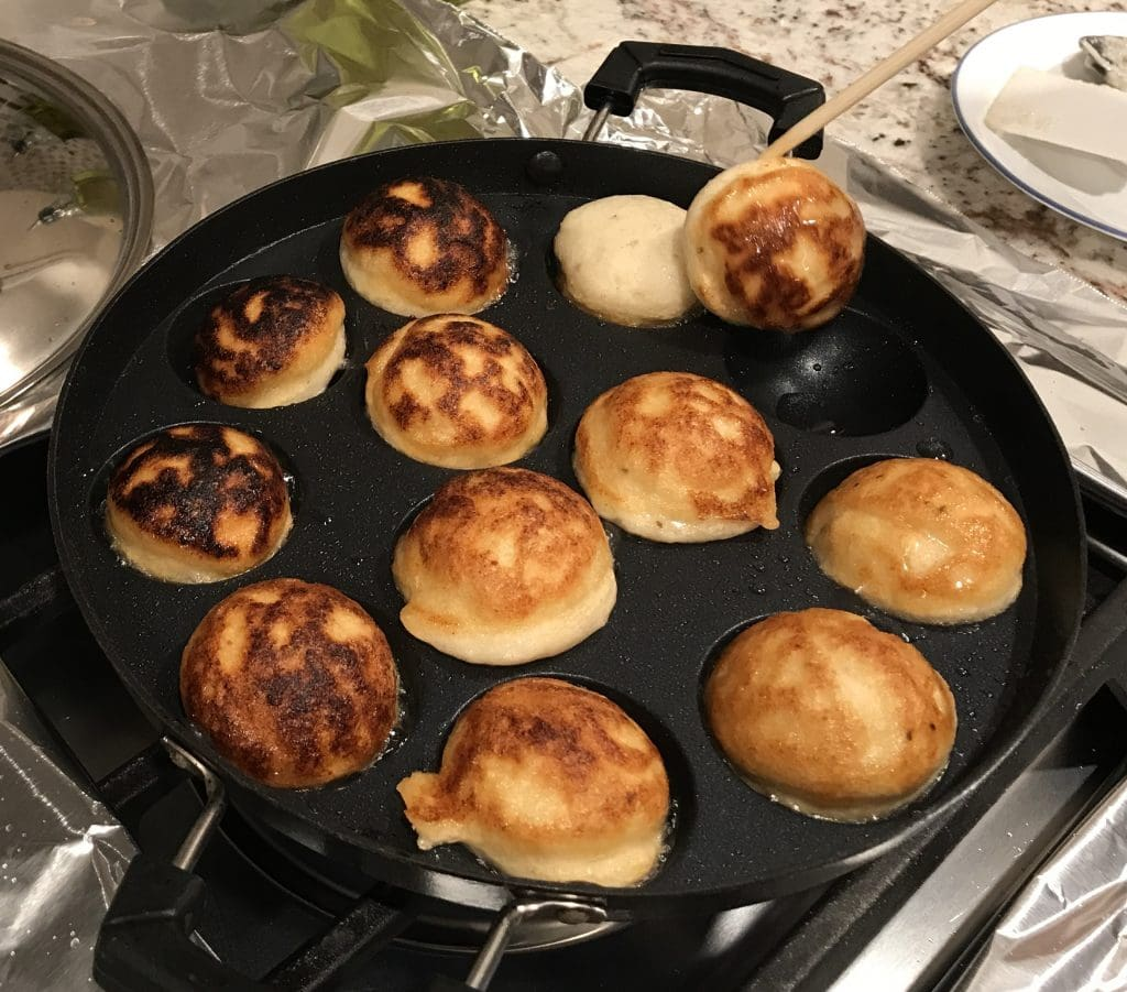 Flipping dahi bhalla in Aebleskiver pan