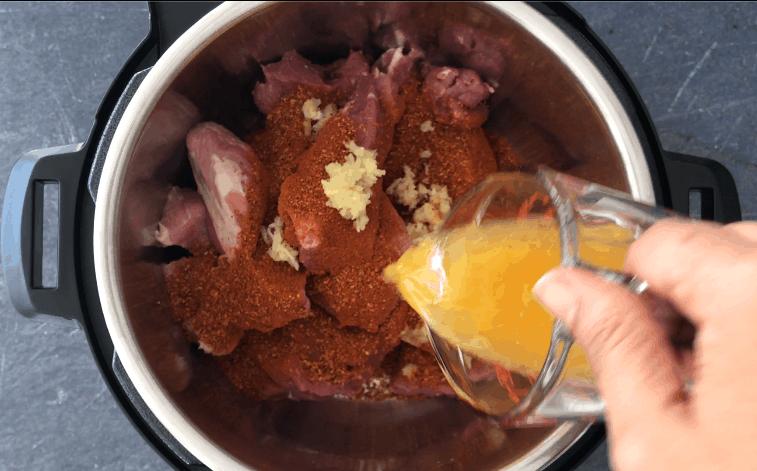 Adding orange juice to the pot