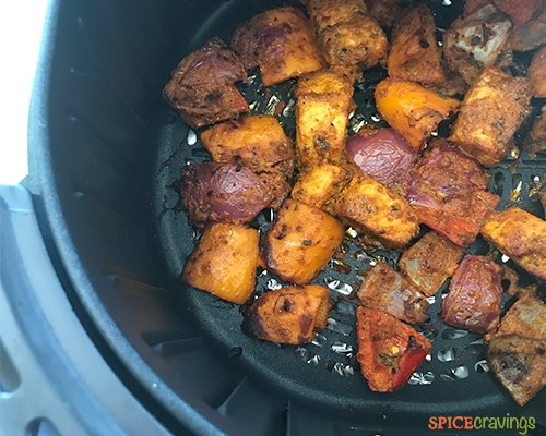 Cooked fish tikka in an airfryer basket