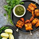 Tandoori Fish Tikka on a black stone plate