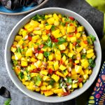 Fresh mango salsa garnished with lime and cilantro