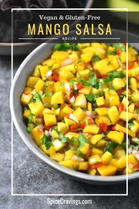 A bowl of colorful mango salsa dip