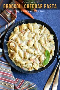 Broccoli cheese pasta garnished with basil