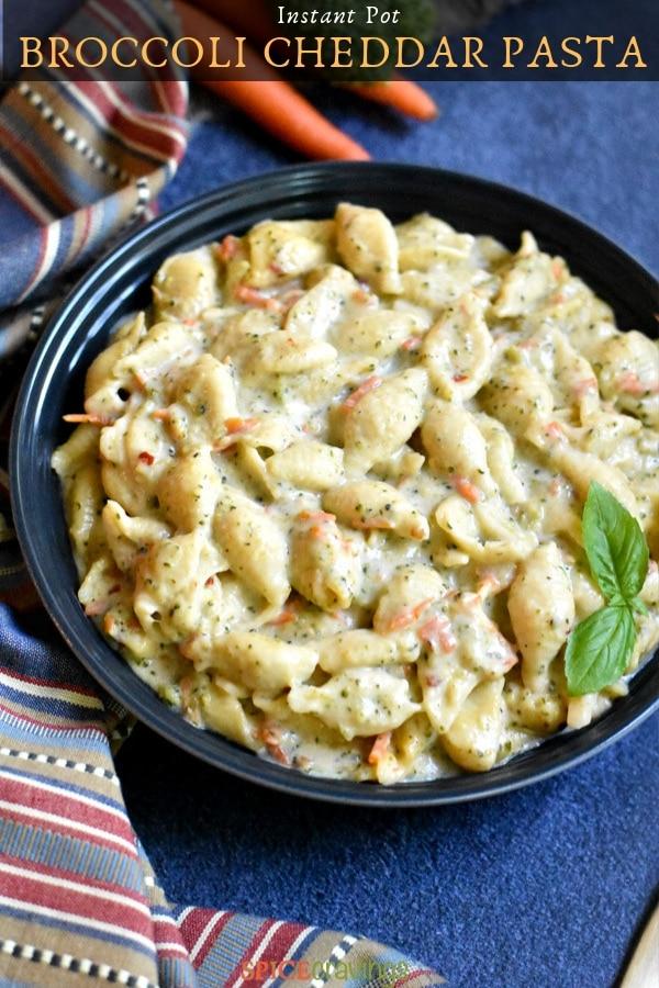 Creamy Broccoli cheddar pasta garnished with basil