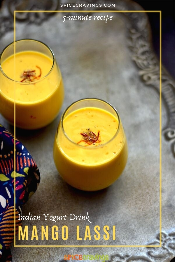 Two glasses of mango lassi garnished with saffron
