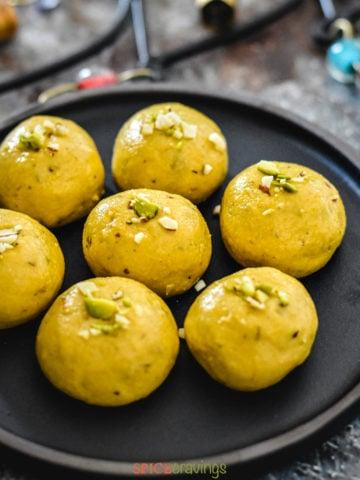 Plate of gram flour fudge balls called besan ke ladoo