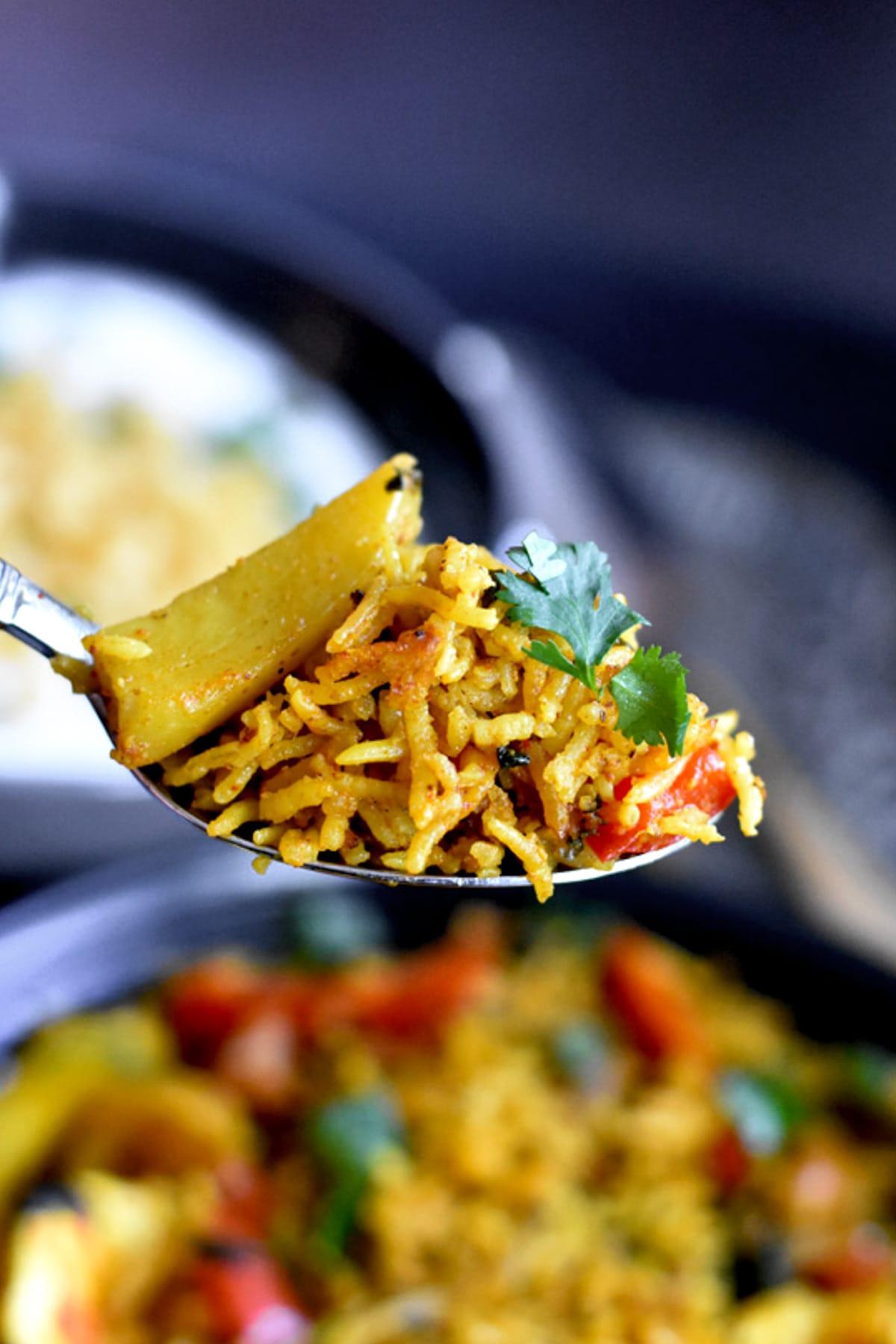 A spoon full of Indian Vegetable Biryani