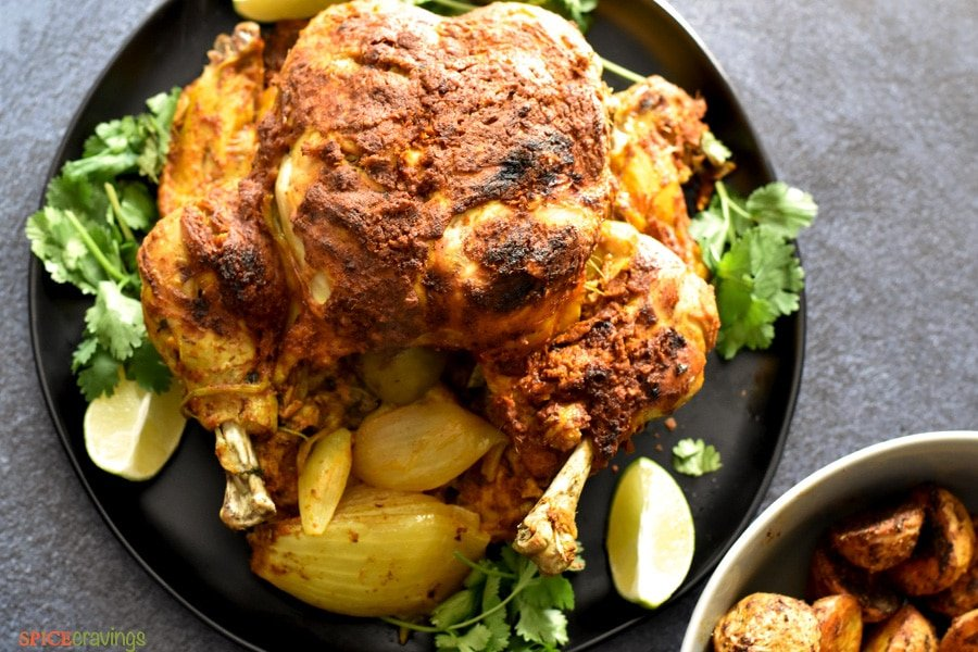 Crisp Tandoori Chicken served with lime and cilantro on the side
