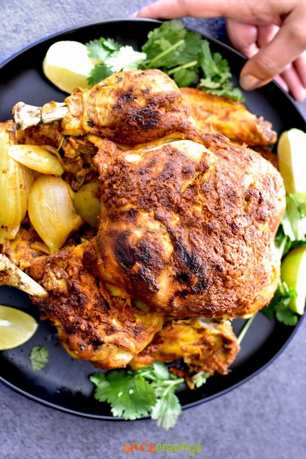 Whole Roasted Chicken on a black plate