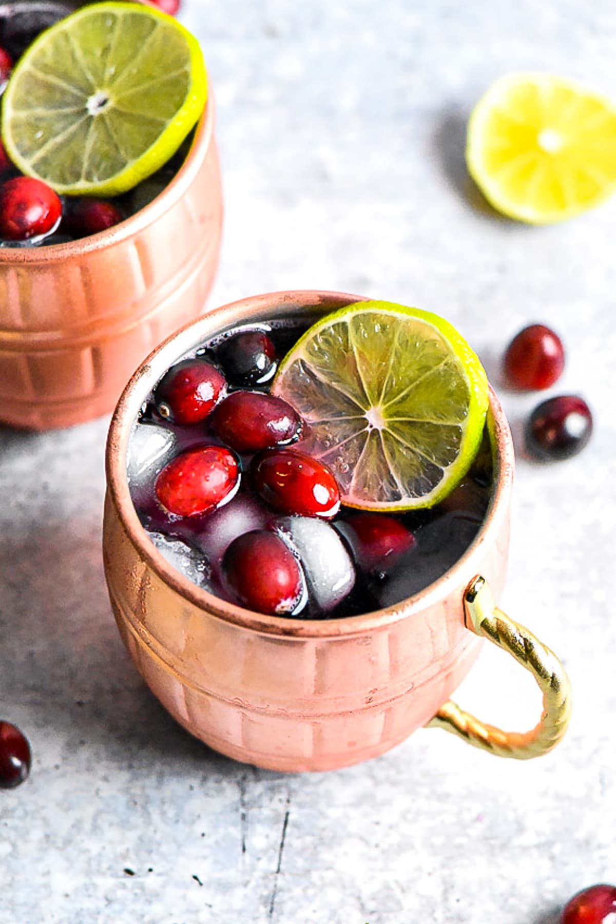 Moscow Mule served in a copper mug, topped with cranberries