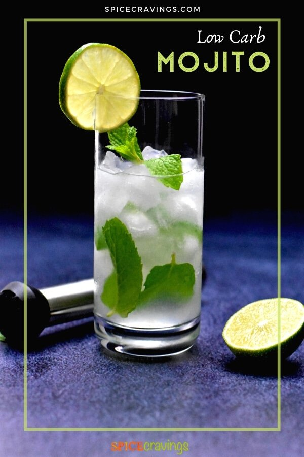 low carb mojito in highball glass garnish with lime slice with muddler and lime on the side