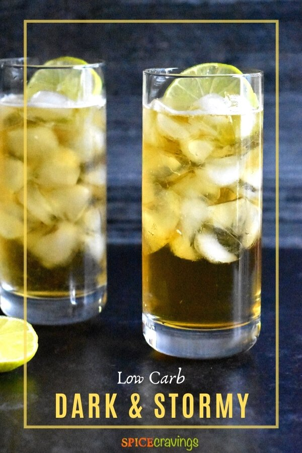 Two glasses of Dark and Stormy Cocktail with a slice of lime