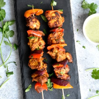 Chicken tikka skewered and grilled with peppers