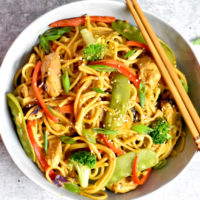Chicken Lo Mein noodles served with chopsticks