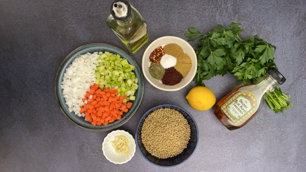 cilantro, lemon, spices in white bowl, lentils, chopped vegetables in bowl, olive oil