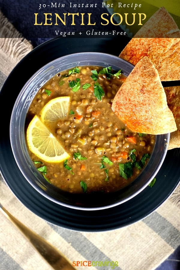 instant pot lentil soup in gray bowl garnished with lemon slices and pita bread