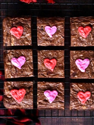 Brownie squares decorated with pink and red icing hearts