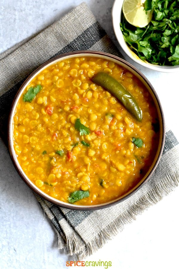 instant pot chana dal recipe in white bowl with cilantro on side