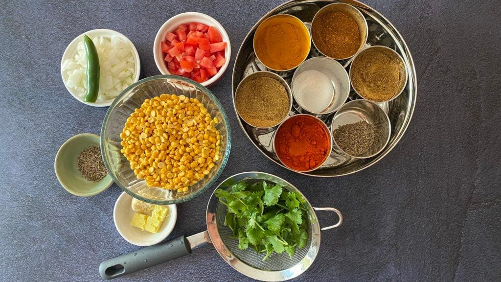 split chickpeas, onions, green chili, tomatoes, spices, cilantro, garlic, ginger