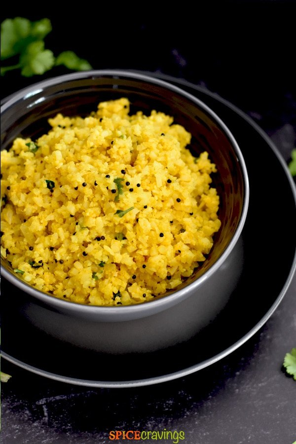 easy side dish of cauliflower in gray bowl on black plate