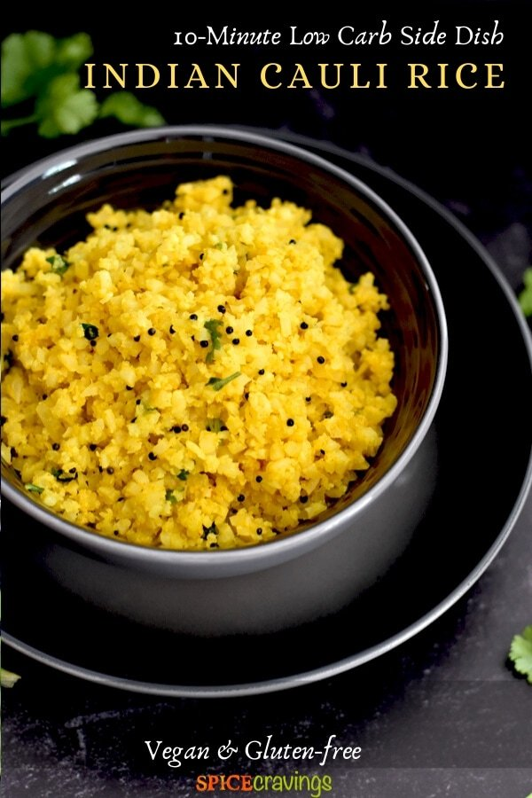 riced cauliflower with spices and mustard seeds in gray bowl on black plate