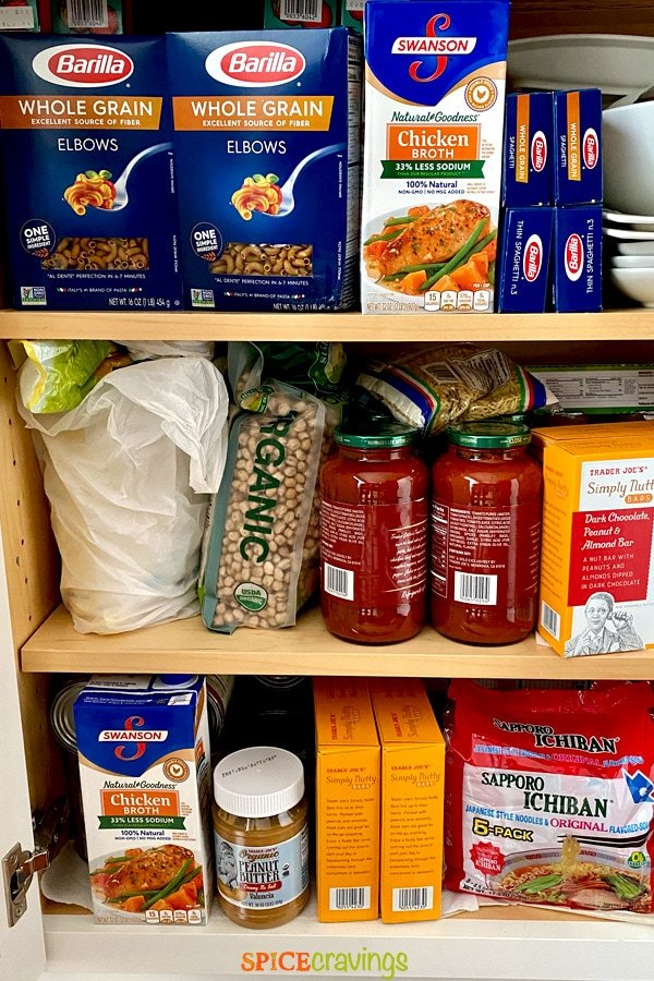 pasta, broth, sauce, noodles and peanut butter stocked in a pantry