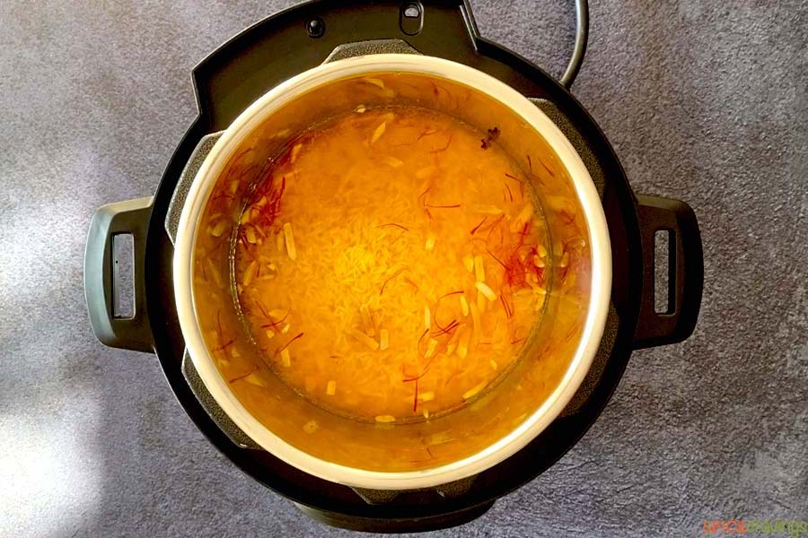 rice and saffron spice simmering in instant pot pressure cooker