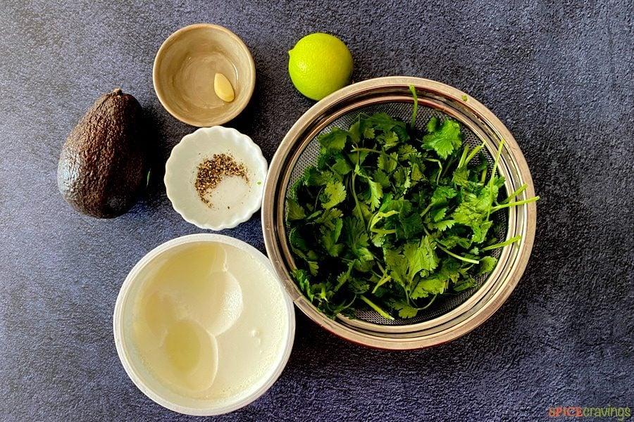 avocado, greek yogurt, cilantro, salt, pepper, garlic, lime