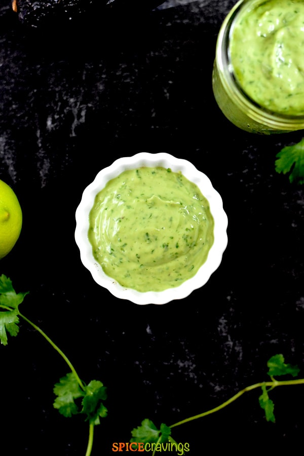recipe for avocado dressing in small white bowl