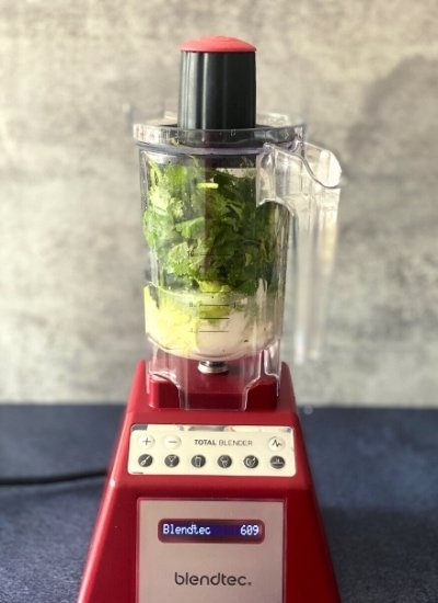 cilantro and avocado in blender with top