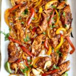 easy chicken fajitas recipe on parchment lined sheet pan