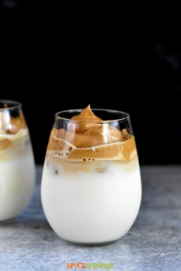 dalgona coffee recipe over milk in two glasses