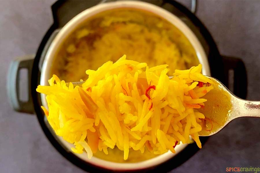 forkful of saffron rice over instant pot