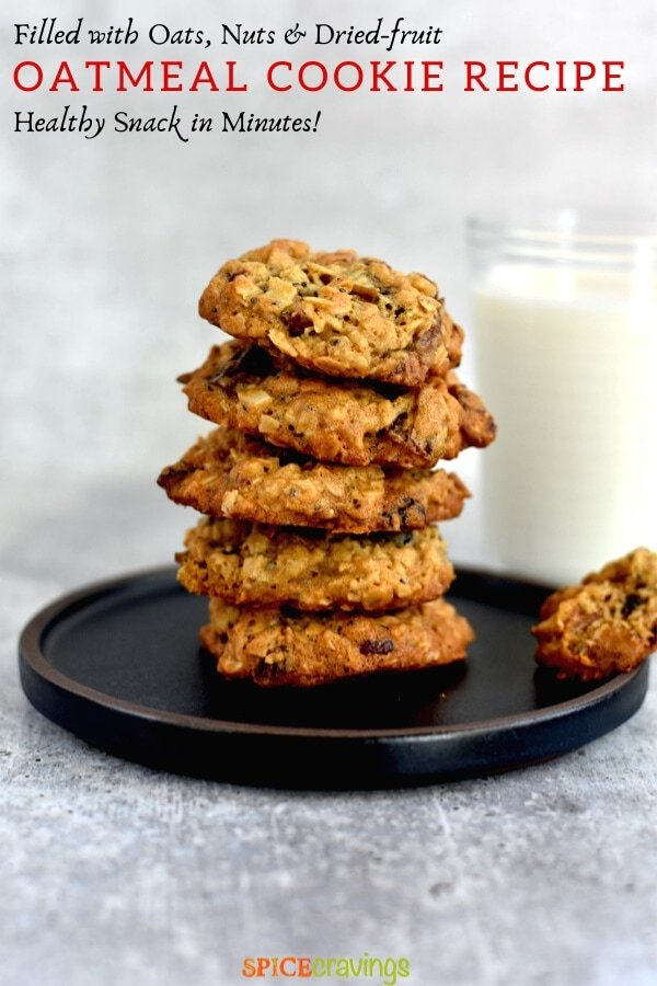 stack of soft and chewy oatmeal cookies with glass of milk