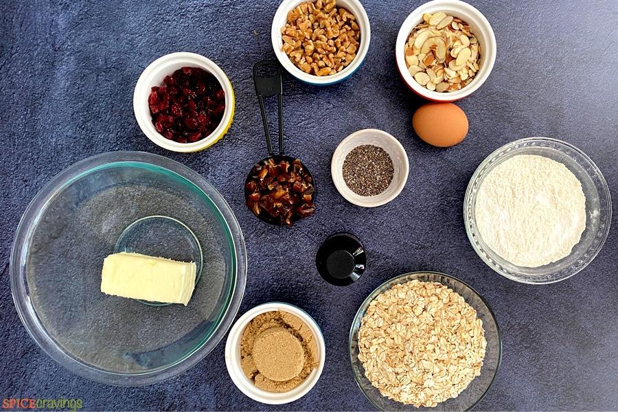 butter, brown sugar, oats, flour, almonds, walnuts, egg, dates, craisins