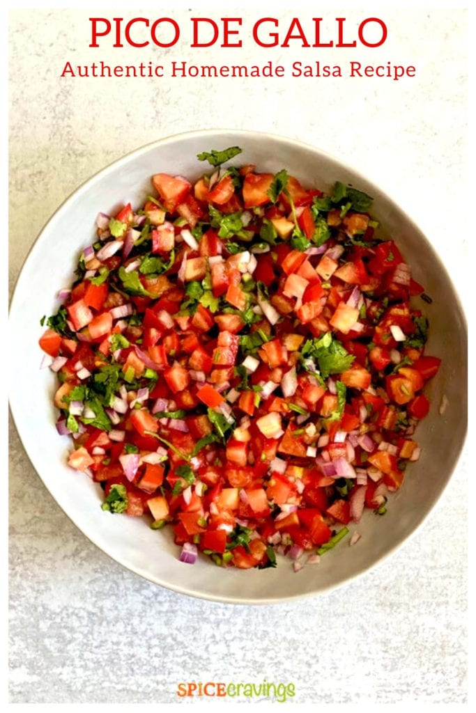 A bowl of salsa made with tomatoes, cilantro, onion