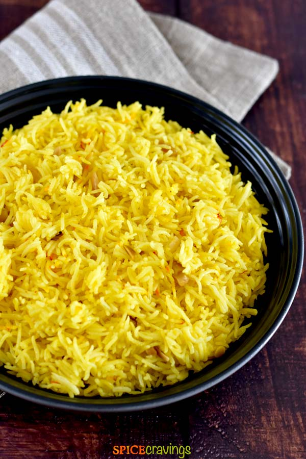 easy rice pilaf with saffron in black bowl