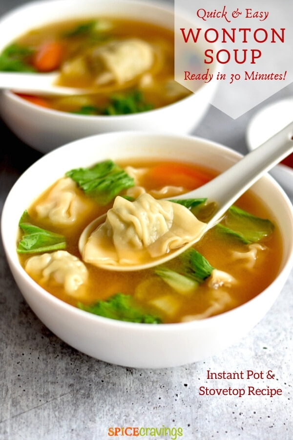 A soup bowl with wontons and spinach