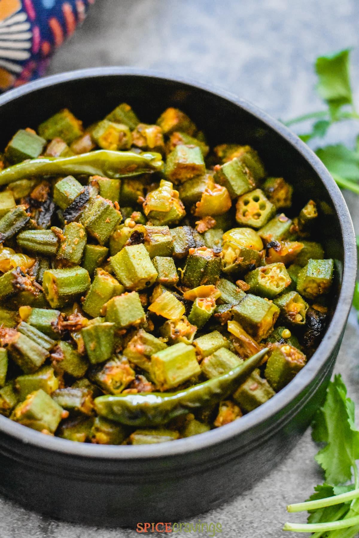 bhindi masala recipe in black bowl