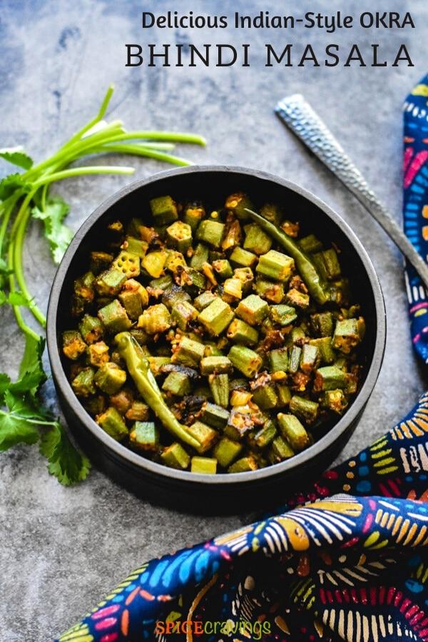 bhindi masala recipe in black bowl with fresh cilantro