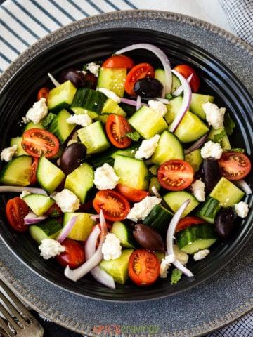 Bowl of chopped cucumber, tomato, onion and feta