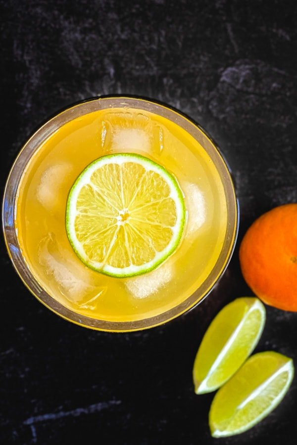 A top shot of a skinny margarita drink with a lime slice floating on top