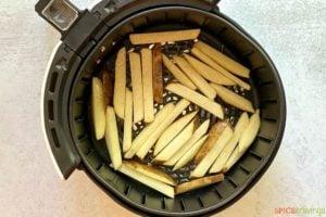 sliced potatoes in air fryer basket