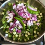 okra, onions and chile in nonstick skillet on stove