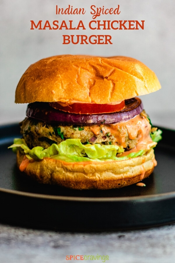 Indian spiced chicken burger with tomato and onion