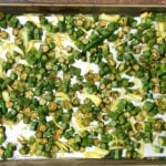 chopped okra with Indian spices on foil lined baking sheet