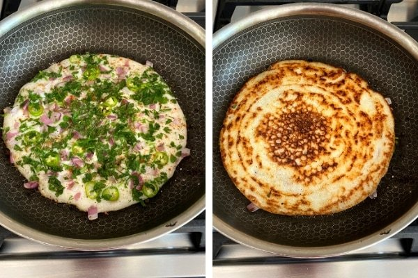 fermented batter cooking in nonstick skillet with onions and herbs, golden brown uttapam in skillet