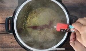 adding tomato paste to aromatics in instant pot